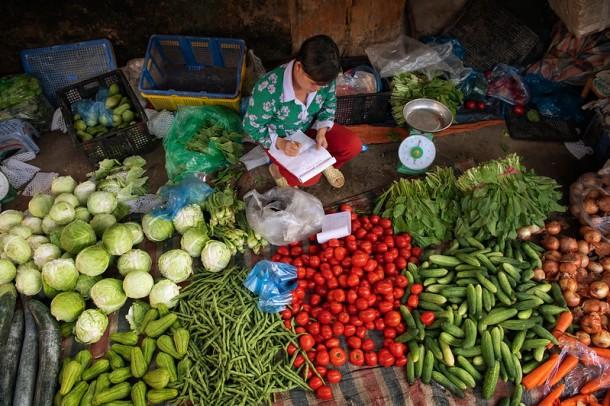 Lu Chi Nguyen, market vendor.